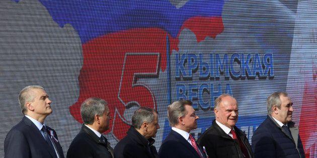 Des officiels russes célèbrent les 5 ans de l'annexion de la Crimée par la Russie, à Simferopol en Crimée,...