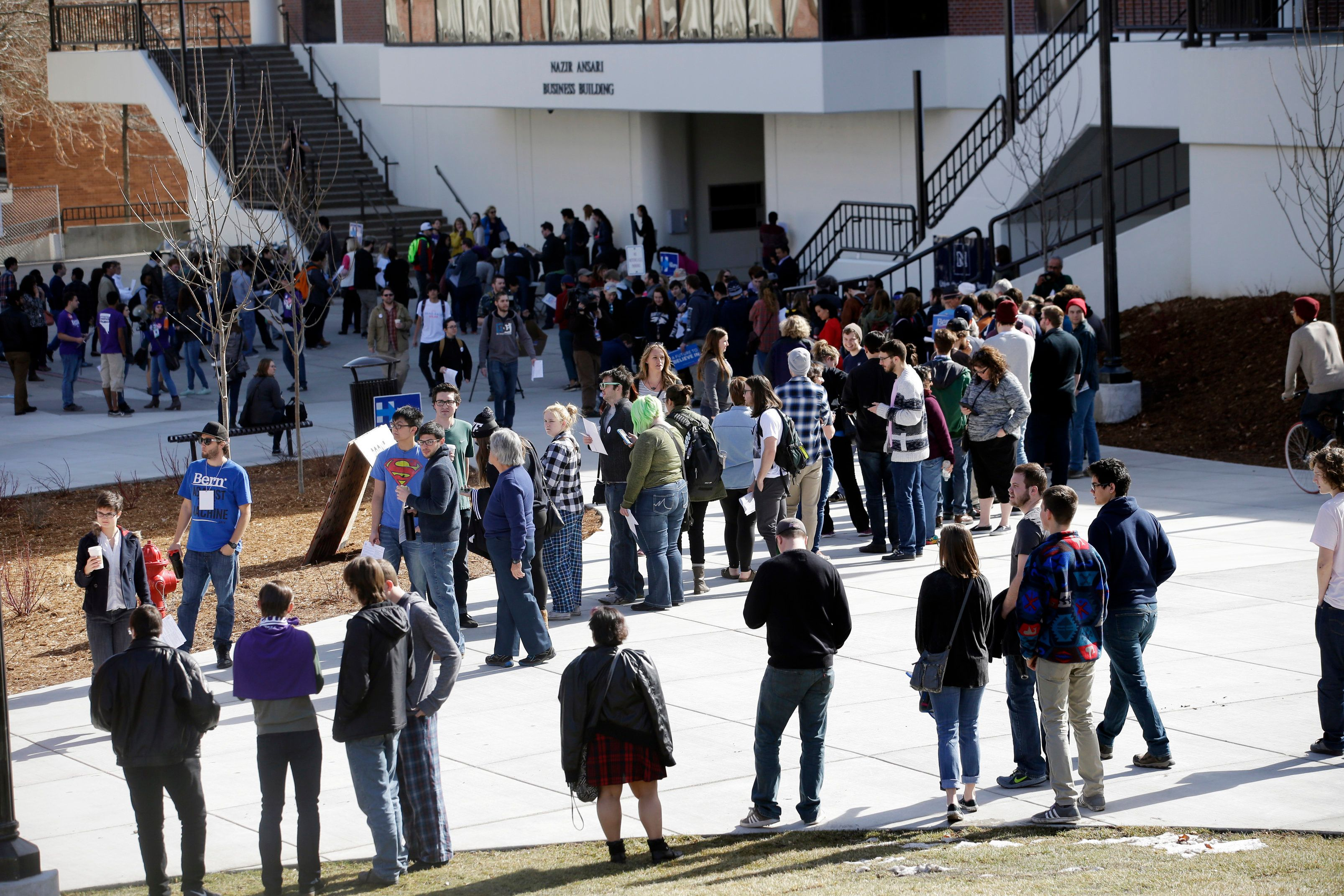 FILE - In this Feb. 20, 2016 file photo people line up to participate in the Democratic caucus at the University of Nevada in Reno, Nev. Nevada Democrats are proposing major changes to their presidential caucuses that could dramatically alter the way candidates compete in the state, opening the process to an early-vote and virtual participation. (AP Photo/Marcio Jose Sanchez,File)
