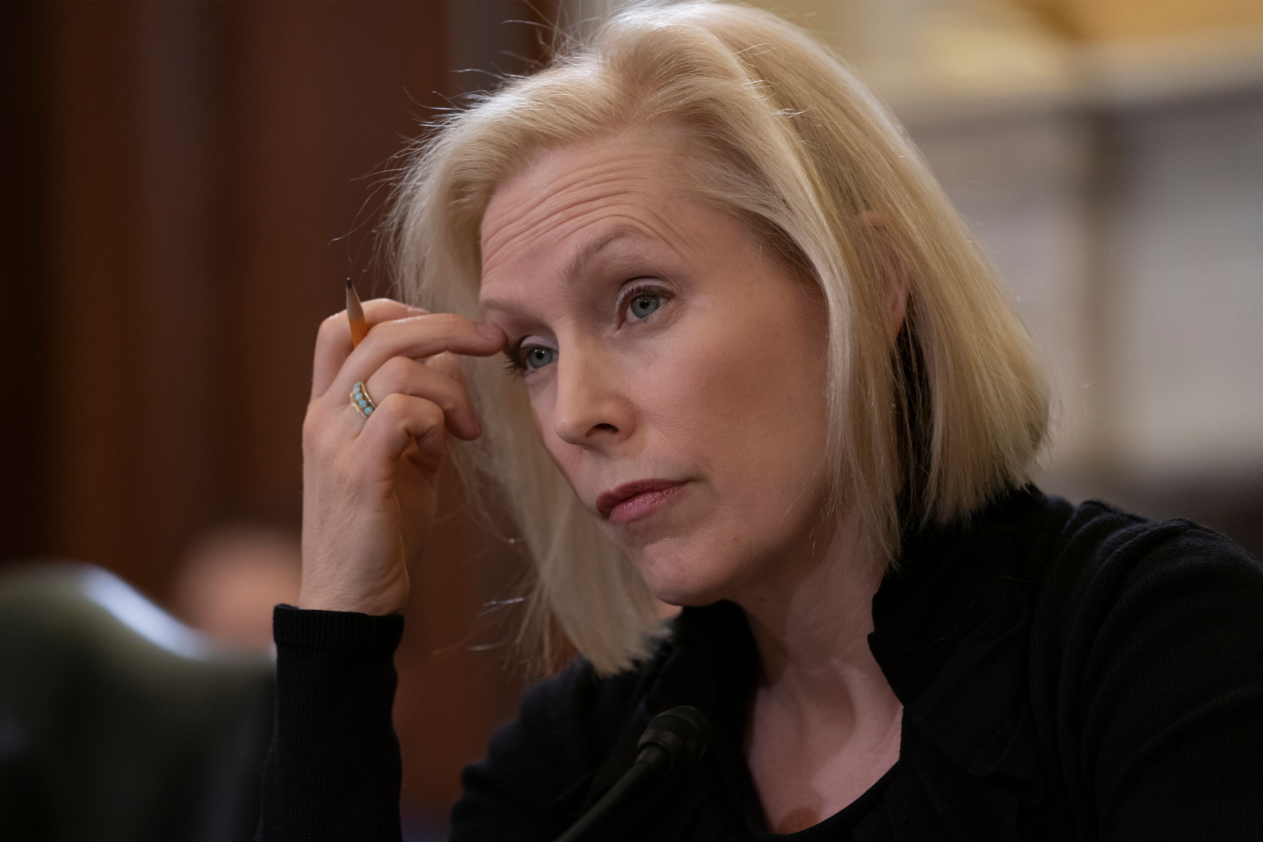 Sen. Kirsten Gillibrand, D-N.Y., the ranking member of the Senate Armed Services Subcommittee on Personnel, listens as the panel holds a hearing about prevention and response to sexual assault in the military, on Capitol Hill in Washington, Wednesday, March 6, 2019. Sen. Martha McSally, R-Ariz., recounted her own experience while serving as a colonel in the Air Force. (AP Photo/J. Scott Applewhite)