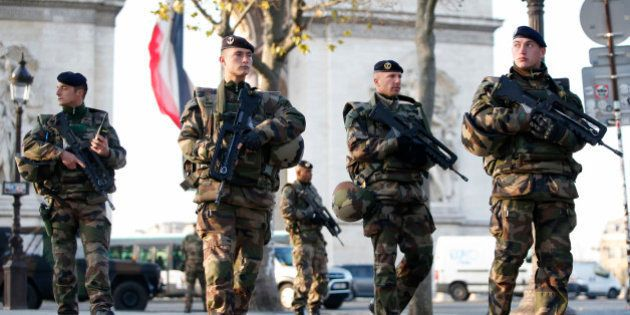 French soldiers patrol in front of the Arc de Triomphe on the Champs Elysees avenue in Paris, France,...