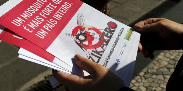 A Brazilian Army soldier shows pamphlets during the National Day of Mobilization Zika Zero in Rio de...