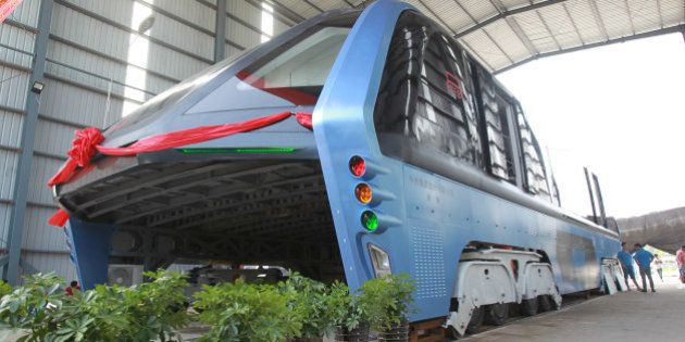 A model of an innovative street-straddling bus called Transit Elevated Bus is seen after a test run in...
