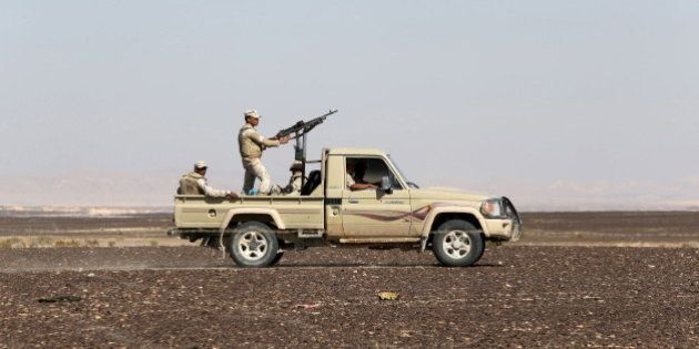 An Egyptian army vehicle guard the site where a Russian airliner crashed in the al-Hasanah area in El...