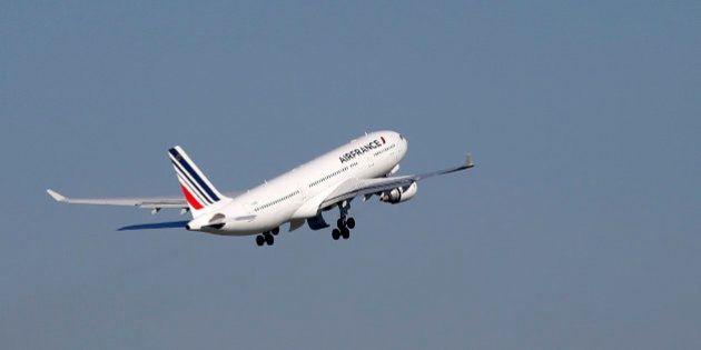 An Air France passenger jet takes off from the Charles-de-Gaulle International Airport in Roissy, France,...