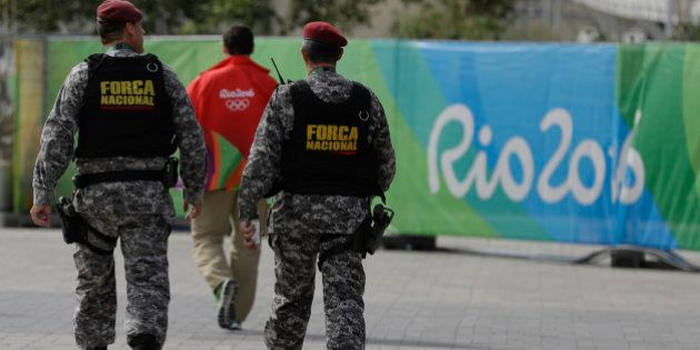 Brazil's security forces walk at the Olympic Park ahead of the 2016 Summer Olympics in Rio de Janeiro,...
