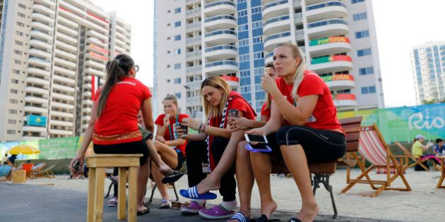 Athletes from Montenegro gather inside the Olympic Village in Rio de Janeiro, Brazil August 1, 2016....