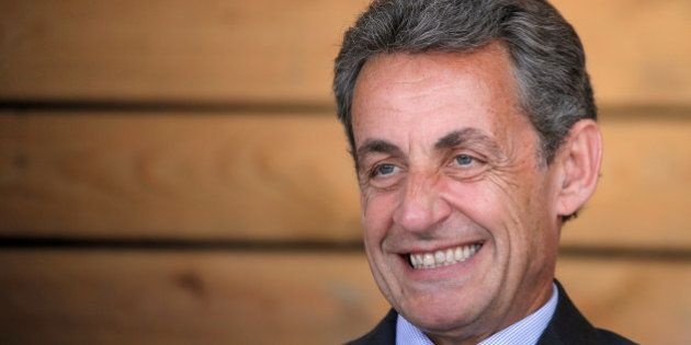 Nicolas Sarkozy (C), head of France's Les Republicains political party and former French president, attends...