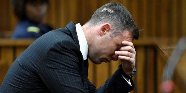 Former Paralympian Oscar Pistorius attends his sentencing for the murder of Reeva Steenkamp at the Pretoria...