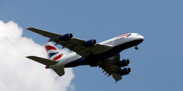 A British Airways Airbus A380-800 descends for a landing at Washington Dulles International Airport as...