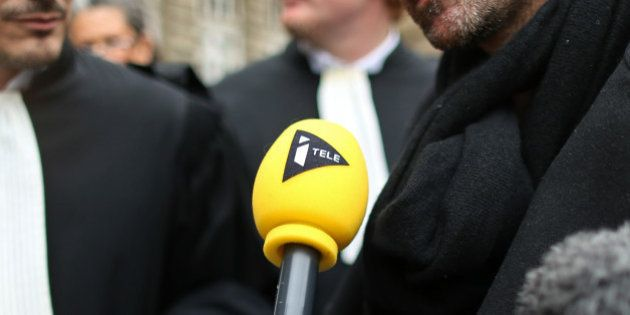A microphone of French TV channels iTele is pictured outside the courthouse in Paris, France, March 21,...