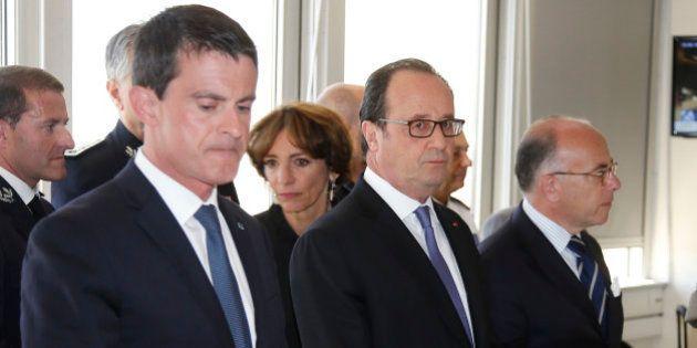 French President Francois Hollande (C), Prime Minister Manuel Valls (L) and Interior Minister Bernard...