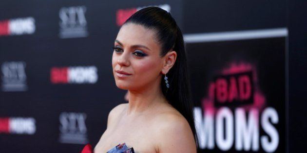Cast member Mila Kunis poses at the premiere