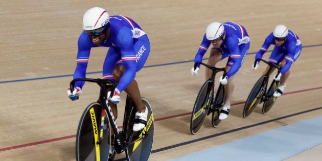Bronze medalists France's team compete in the men's team sprint finals at the Rio Olympic Velodrome during...
