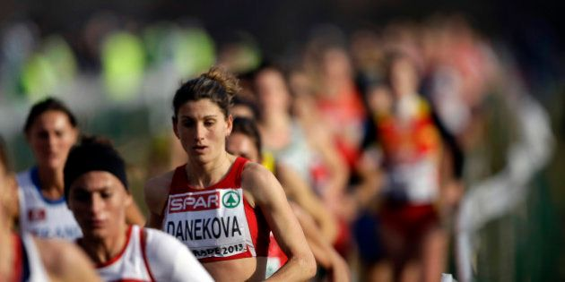 Bulgaria's Silvia Danekova and other runners compete in the Senior Women's race at the European Cross...