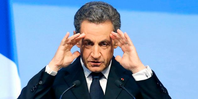 file - In this Sept.27, 2015 file photo, former French President Nicolas Sarkozy reacts during the meeting...