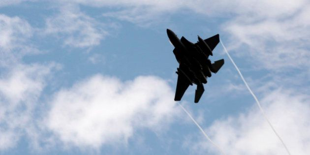 A U.S. F-15 jet fighter leaves after an airstrike against Taliban insurgent positions in eastern Afghanistan's...