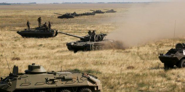 Ukrainian tanks and APCs move towards the de-facto border with Crimea near Kherson, southern Ukraine,...