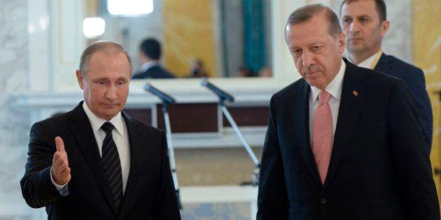 Russian President Vladimir Putin, left, and Turkish President Recep Tayyip Erdogan attend a news conference...