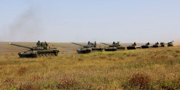 A column of Ukrainian tanks and APCs move towards the de-facto border with Crimea near Kherson, southern...