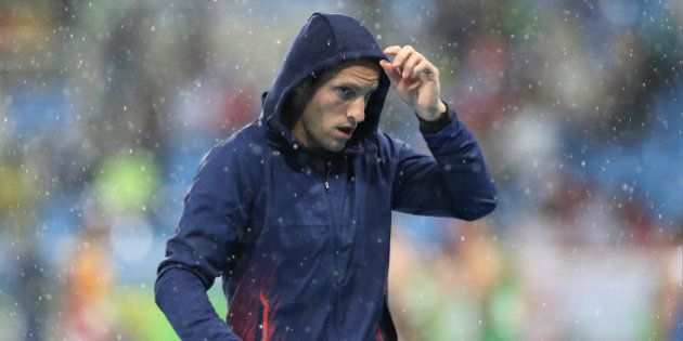 France's Renaud Lavillenie leaves the stadium after the competition was suspended during the athletics...