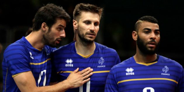France's Franck Lafitte, left, Antonin Rouzier and Earvin Ngapeth (9) walk to shake hands with member...