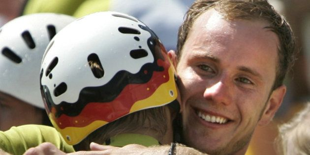 Germany's Stefan Henze (R) celebrates with teammate Marcus Becker after winning the silver medal in the...