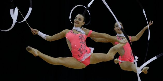 Members of Switzerland's team compete in the International Group Rythmic Gymnastics event in east London...