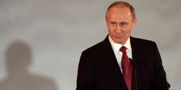 Russian President Vladimir Putin speaks at a meeting in the Strategic Initiatives Agency in Moscow, Russia,...