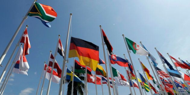 The German flag is hung a half staff outside the canoe venue during the 2016 Summer Olympics in Rio de...