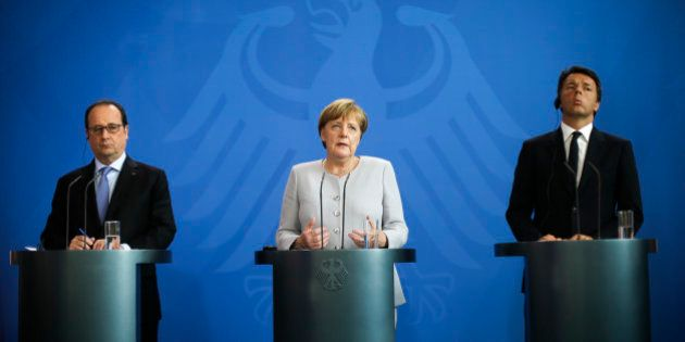 FILE - In this Monday, June 27, 2016 file photo, German Chancellor Angela Merkel, center, the Prime Minister...