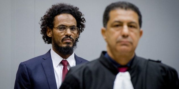Ahmad Al Faqi Al Mahdi ( a.k.a. Abu Tourab) enters the courtroom of the International Criminal Court...