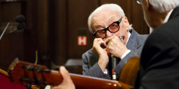 Belgian musician Toots Thielemans plays harmonicza during a ceremony for his 90th birthday at Brussels'...