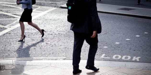 People walking on street with 'lok' written on road,