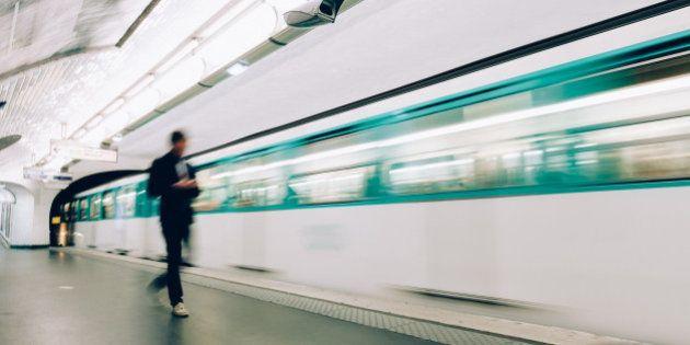 Man boarding train at metro station in