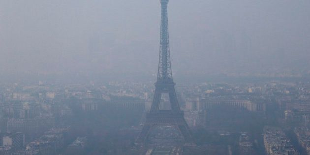 A general view shows the Eiffel Tower and the Paris skyline through a small-particle haze March 18, 2015....