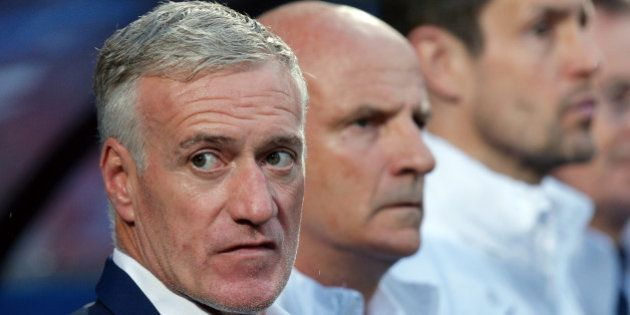 France coach Didier Deschamps, left, wait for the start of the friendly soccer match between France and...
