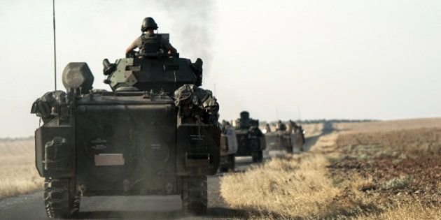 Turkish troops head to the Syrian border, in Karkamis, Turkey, Saturday, Aug. 27, 2016. Turkey on Wednesday...