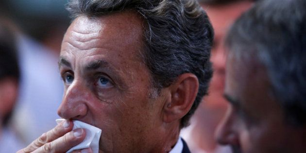 Nicolas Sarkozy, former head of the Les Republicains political party and a former French president, attends...