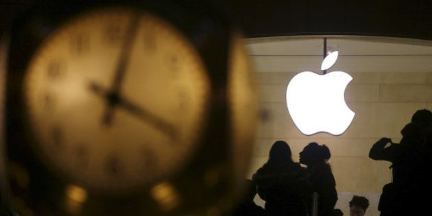 The Apple logo is pictured behind the clock at Grand Central Terminal in the Manhattan borough of New...