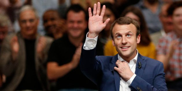 French Economy Minister Emmanuel Macron attends a political rally for his recently launched political...