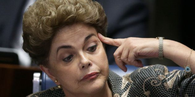 Suspended Brazilian President Dilma Rousseff reacts during her impeachment trial at the Federal Senate...