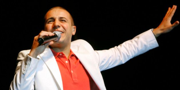 French-Algerian singer Faudel performs during a concert in the west bank city of Ramallah July 9, 2008....