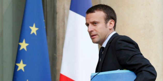 French Economy Minister Emmanuel Macron arrives to attend the weekly cabinet meeting in Paris, France,...