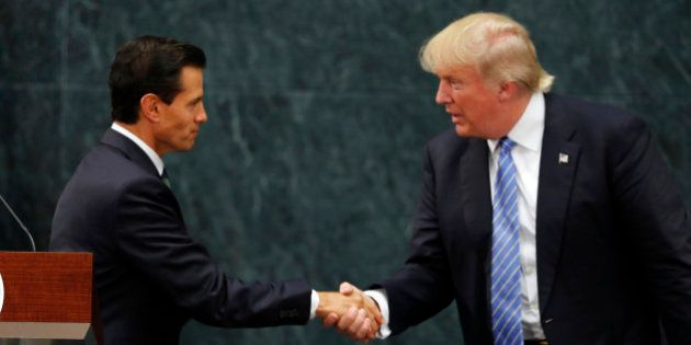 Mexico President Enrique Pena Nieto and Republican presidential nominee Donald Trump shake hands after...