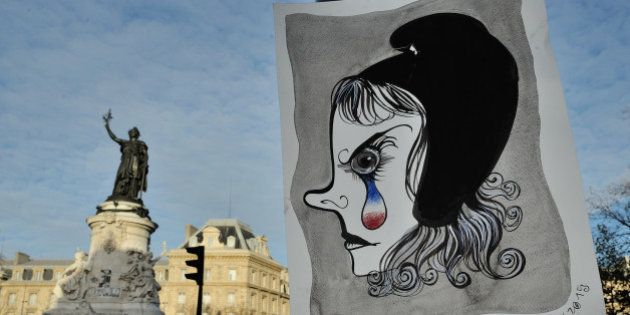 In this photo taken on Sunday Nov. 22, 2015 in Paris shows a drawing of a Marianne, symbol of the French...