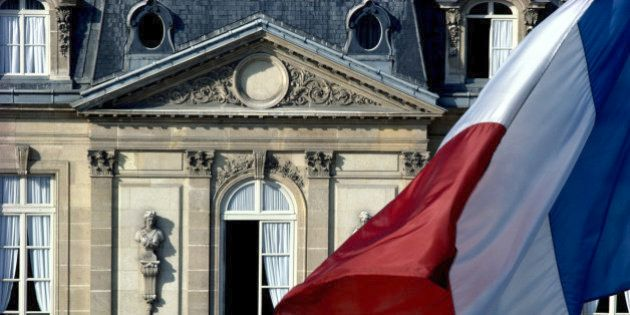 France, Paris, Elysee Palace, French flag in foreground,
