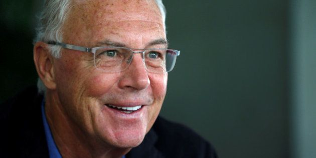 Bayern Munich's former President Franz Beckenbauer speaks to the media during a news conference in Seoul...