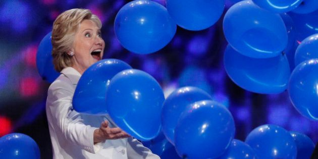 Democratic U.S. presidential nominee Hillary Clinton celebrates with balloons after she accepted the...