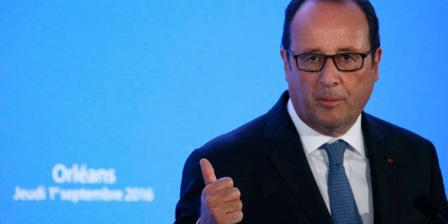 French President Francois Hollande delivers a speech after a visit to a primary school on the first day...