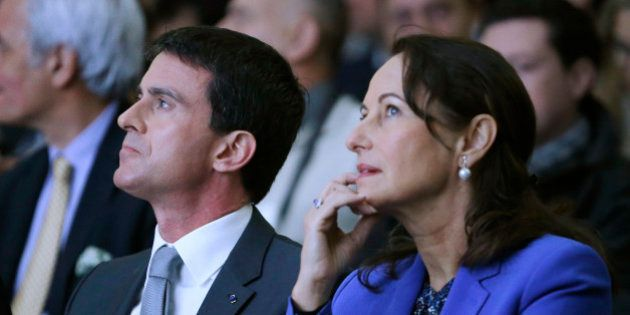 France's Prime Minister Manuel Valls (L) and Ecology, Sustainable Development and Energy Minister Segolene...